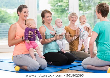 women and their babies in mother child gymnastic course stock photo © kzenon
