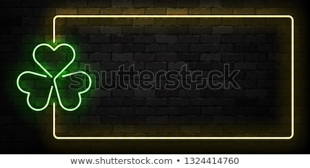 St Patricks Day Neon sign and green brick wall. Realistic sign.  Stock photo © popaukropa