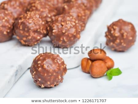 Luxus csokoládé cukorkák mogyoró darabok menta Stock fotó © DenisMArt