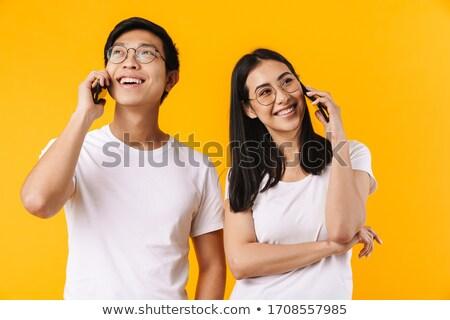 feliz · asiático · homem · falante · telefone · móvel · caminhada - foto stock © deandrobot