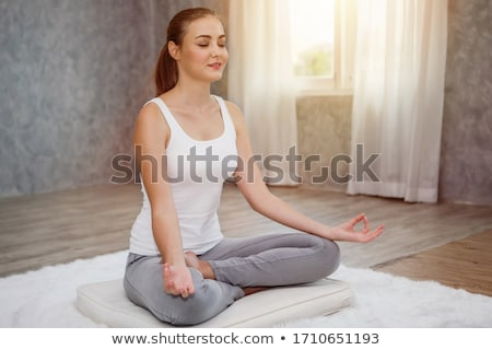 Giovani bella flessibile ragazza yoga home Foto d'archivio © jossdiim