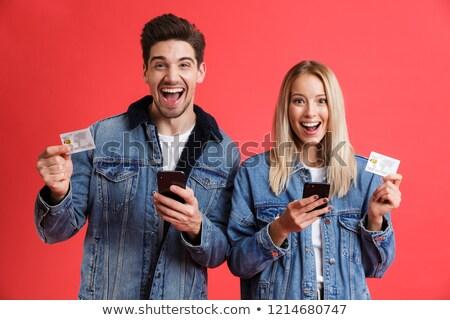 Excité jeunes affectueux couple jeans denim Photo stock © deandrobot