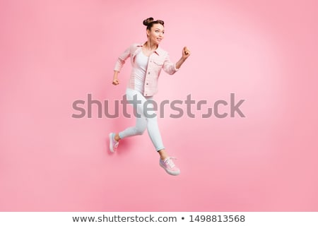full length portrait of a strong young woman stock photo © deandrobot