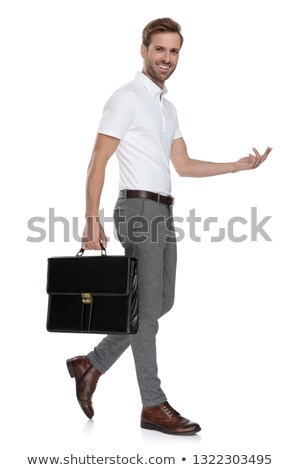 side view of a laughing man with suitcase and welcoming stock photo © feedough