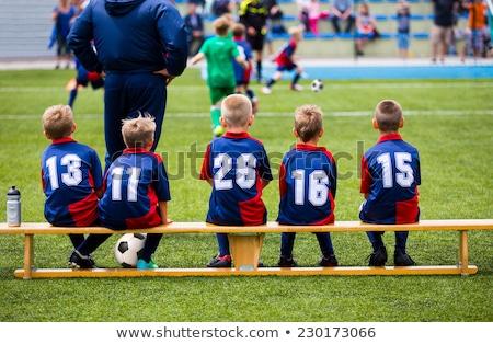 Fiúk ül futball futball fából készült pad Stock fotó © matimix