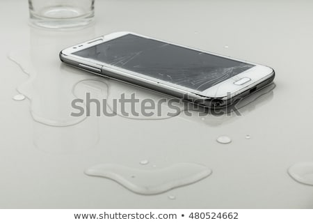 Spilled Water On Smart Phone Stock photo © AndreyPopov