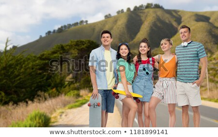 friends with skateboards over big sur hills stock photo © dolgachov