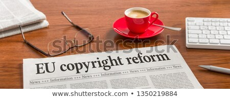A newspaper on a wooden desk -EU copyright reform Stock photo © Zerbor