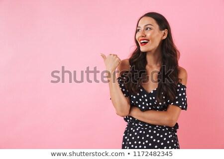 Asian kobieta stwarzające różowy wskazując obraz Zdjęcia stock © deandrobot