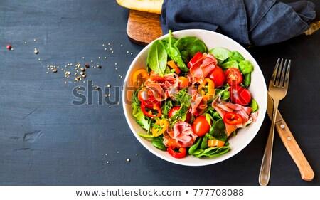 Egészséges saláta prosciutto paradicsom zöld levelek étel Stock fotó © furmanphoto
