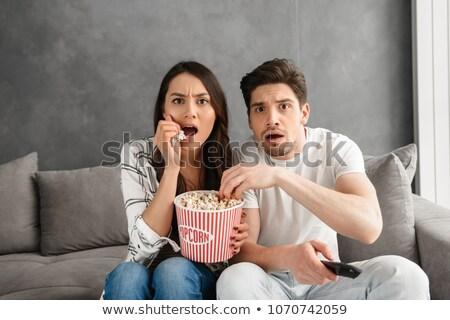 ritratto · attrattivo · mangiare · popcorn · seduta - foto d'archivio © deandrobot