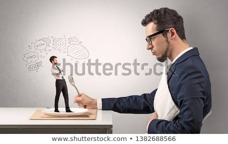 Businessman want to eat small man  Stock photo © ra2studio