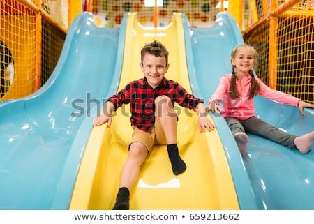 Jongen meisje opblaasbare slide glimlach gelukkig Stockfoto © galitskaya