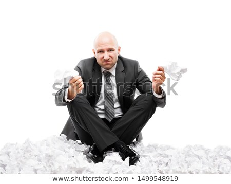 Angry businessman in depression hand holding crumpled torn paper document Stock photo © ia_64