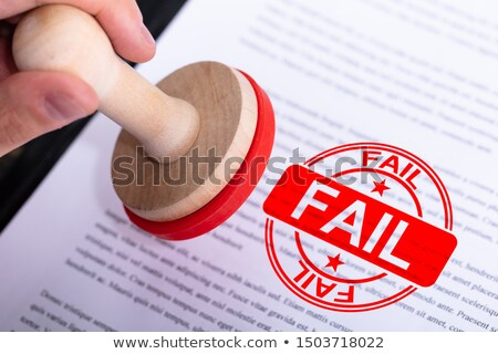 businessman putting fail stamp on document stock photo © andreypopov