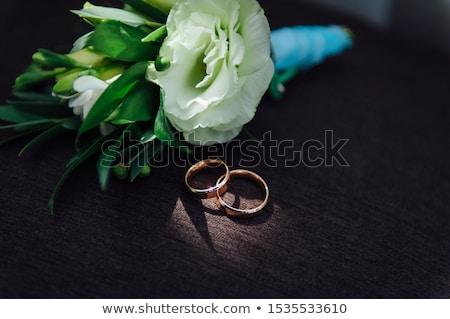Gold wedding rings with flowers around-close-up. sunny day Stock photo © ruslanshramko