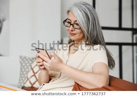 mobiltelefon · üzletasszony · ház · dolgozik · kérdések · üzlet - stock fotó © microolga