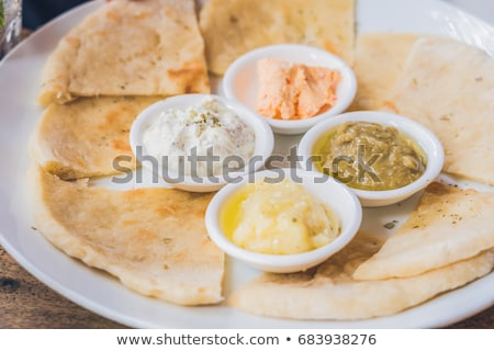 Pieces of pita bread and four kinds of Greek sauces. Greek food concept Stock photo © galitskaya