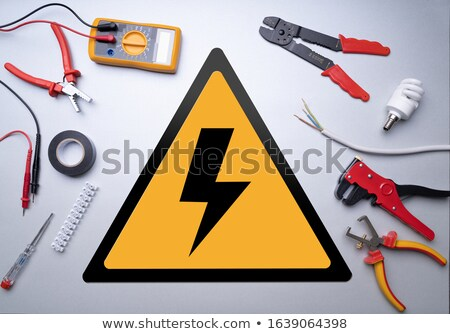Electrician Tools Around High Voltage Sign Stock photo © AndreyPopov