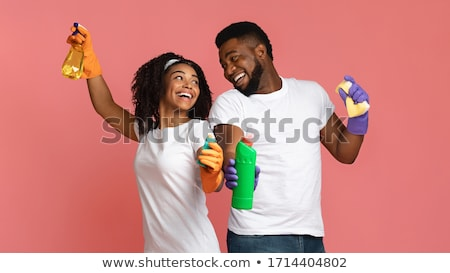african american woman with mop cleaning at home Stock photo © dolgachov