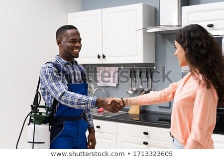 Feliz mulher manutenção trabalhador casa Foto stock © AndreyPopov