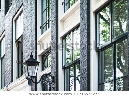 Architectural detail of a building on the main city center street of Amsterdam in Netherlands Stock photo © Anneleven