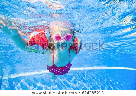 girl under water of the pool stock photo © ruslanomega