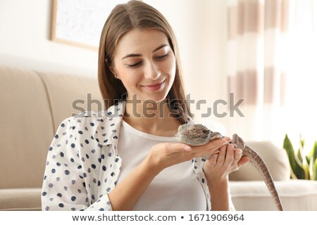 Cute woman holding lizard Stock photo © konradbak