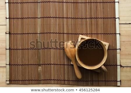 Coffee on bamboo mat top view. Stock photo © borysshevchuk