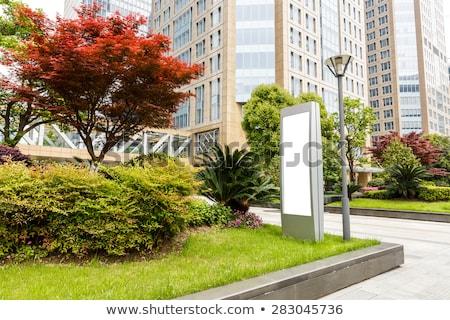 Hirdetés modern épület város utca üveg felirat Stock fotó © cozyta