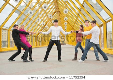 guy holds belts in the hands, they pull others for them on footbridge Stock photo © Paha_L