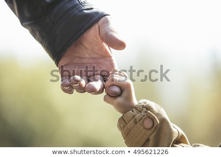 Grandfather with  granddaughter on hands with yellow leafs Stock photo © Paha_L