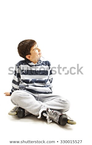 Boy on rollerblades sits with crossed legs Stock photo © Paha_L