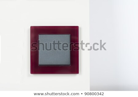 Light Switch On The Wall With Grey Button On Glass Frame Foto stock © tarczas