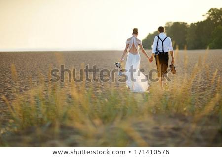 花嫁 · 新郎 · 一緒に · 結婚式のブーケ · 抱擁 - ストックフォト © vichie81