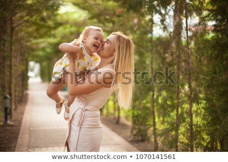 mather baby daughter playing stock photo © anna_om