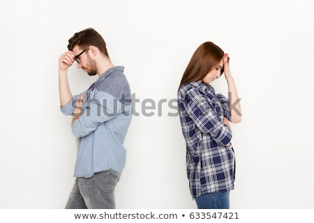 young troubled couple isolated on white stock photo © dacasdo