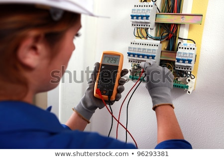female electrician checking a fusebox stock photo © photography33
