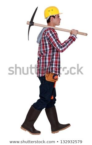 Tradesman carrying a pickaxe Stock photo © photography33