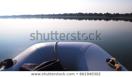rubber boat on coast marsh Stock photo © basel101658