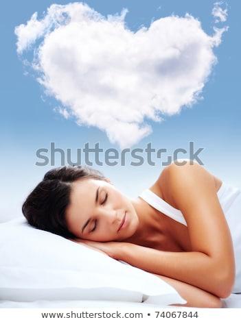 брюнетка красоту кровать облака стороны счастливым Сток-фото © konradbak