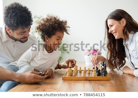 Mother and young daughter playing chess together Stock photo © photography33