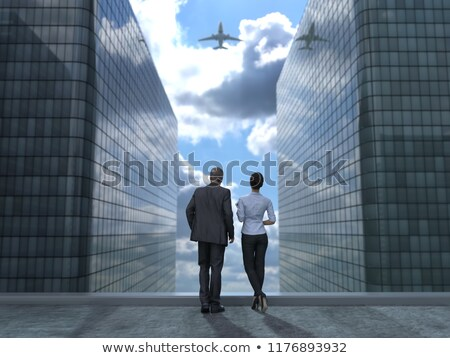 Businessman standing with a woman and light aircraft Stock photo © photography33