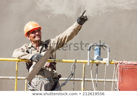 Decorator pointing into distance Stock photo © photography33