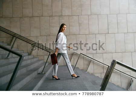 Fashionable Woman Walking  Stock photo © lorenzodelacosta