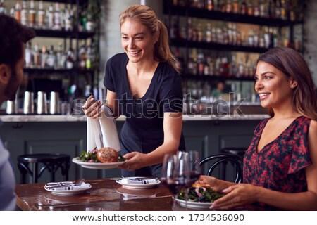 Waitress serving drinks Stock photo © photography33