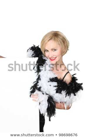 Stock photo: Diva in a black and white feather boa and a board left blank for your message
