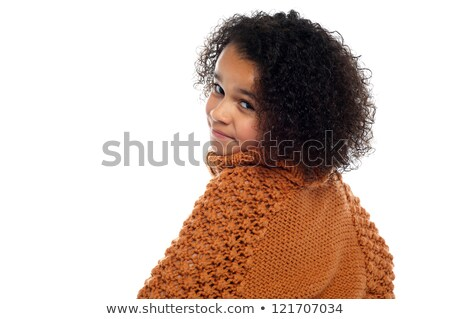 Little girl with over sized sweater on turning back stock photo © stockyimages