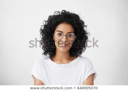 Joyful woman posing while standing against a white background stock photo © wavebreak_media