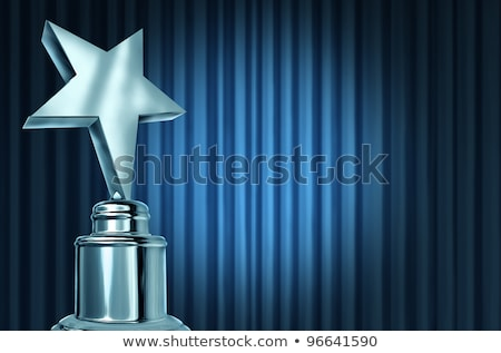 Silver Star Award On Blue Curtains Stock photo © Lightsource